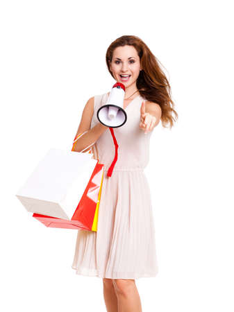 loud hailer: attractive woman with shopping bags and megaphone on isolated background