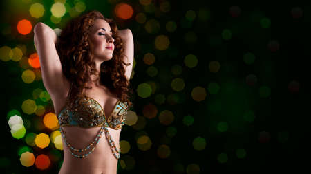 bellydance: attractive bellydancer in front of bokeh background