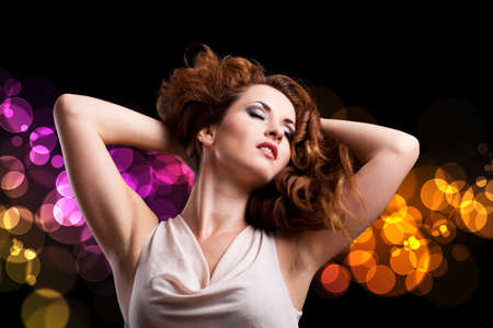 ravishing: young woman in front of a club background