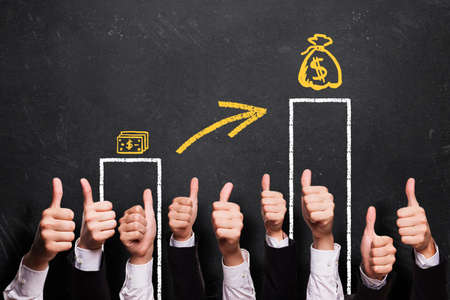 pay raise: many thumbs up to a pay raise Stock Photo