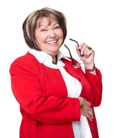 high spirited: senior smiling businesswoman with glasses