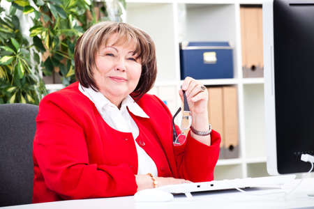 executive affable: senior businesswoman in an office Stock Photo