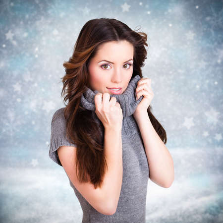 wind blown hair: attractive woman in front of a winter scene