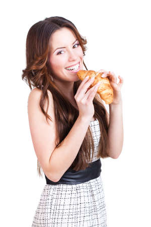 high spirited: attractive woman with a croissant Stock Photo