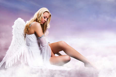 an angel on clouds