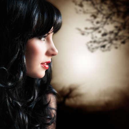 tantalizing: attractive melancholic woman Stock Photo