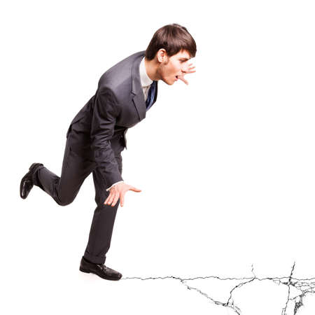 cracking: businessman balancing on cracking ground Stock Photo
