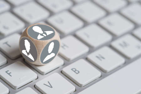 cube on a keyboard with person symbols