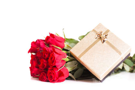 well loved: bouquet of roses and a gift