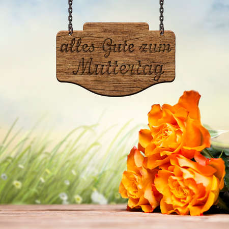 best wishes: roses with wooden message board saying Best wishes for Mothers Day in German Stock Photo