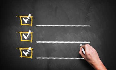 checklist on a chalkboard 스톡 콘텐츠