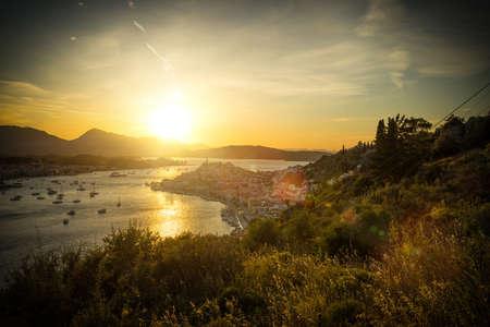 poros: sunset in Poros Greece Stock Photo
