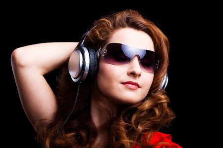ravishing: young woman with headphones Stock Photo
