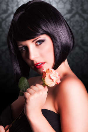 black hair blue eyes: attractive smiling woman with a rose