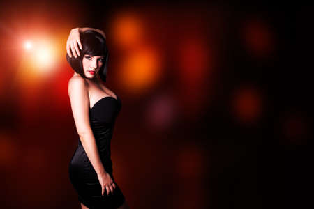 sexy woman disco: young woman in front of a club background