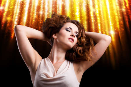 ravishing: young woman in front of a firework background Stock Photo