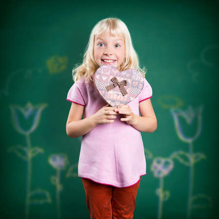heart shaped box: young girl with a heart shaped box Stock Photo