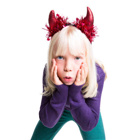 misbehaving: young girl with devils horns on her head