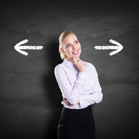 left behind: businesswoman has to decide between two directions