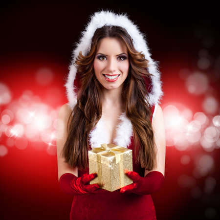 mrs santa: attractive miss santa with a gift box Stock Photo
