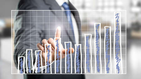 turnaround: businessman touching a chart Stock Photo