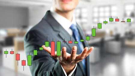 stock price: businessman holding a virtual stock price chart