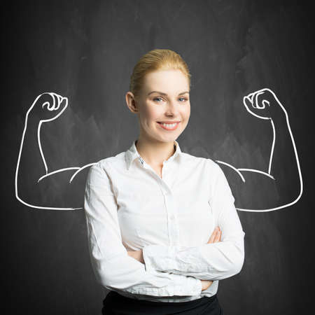 businesswoman with drawing symbolizing power Stockfoto