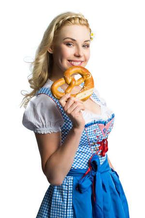 dirndl dress: beautiful woman in a traditional bavarian dirndl