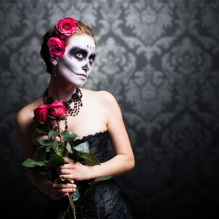 costume party: attractive woman with sugar skull make-up