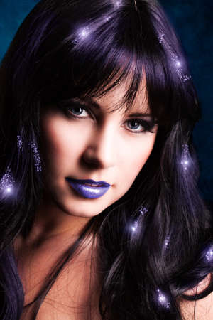 tantalizing: attractive woman with magical light effects in the hair Stock Photo