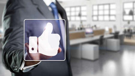 approval: businessman touching like symbol Stock Photo