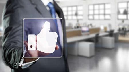 of ratification: businessman touching like symbol Stock Photo