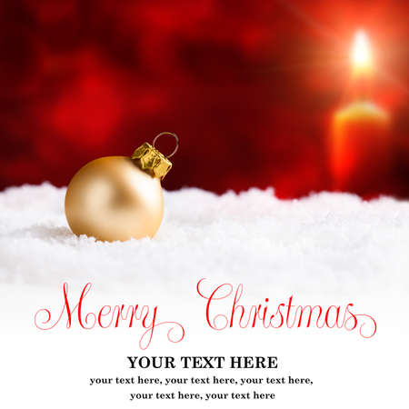 the end of the year: christmas ball in the snow with merry christmas greeting and sample text