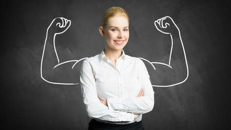 strong women: businesswoman with drawing symbolizing power Stock Photo