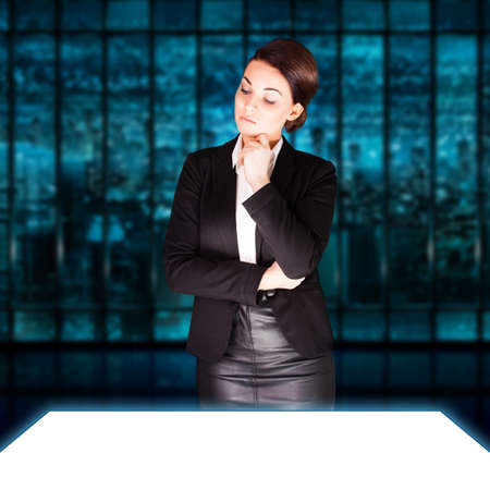 envisage: attractive businesswoman looking at a large white screen Stock Photo