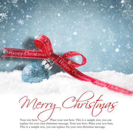 the end of the year: christmas ball in the snow with merry christmas greeting Stock Photo
