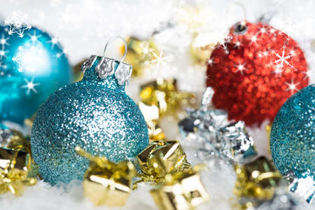 christmas decor: christmas ball in the snow with merry christmas greeting Stock Photo