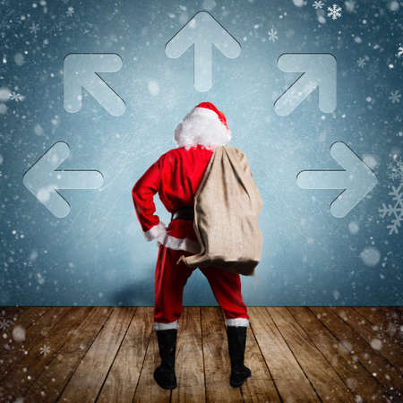 st  nick: Santa Claus with a bag of presents looking at a icy wall