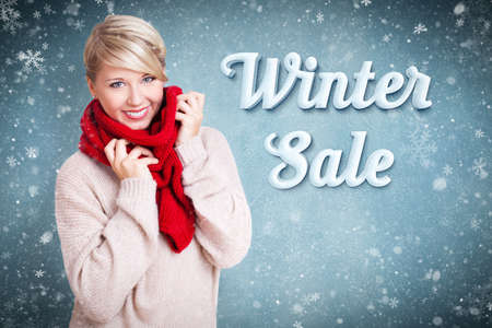 vitality: attractive blonde woman with winter clothes and the snowy message winter sale