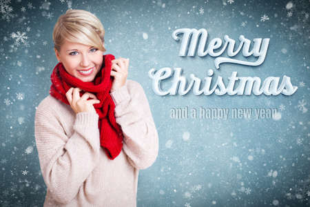 christmas woman: attractive blonde woman with winter clothes and the snowy message Merry Christmas and a happy new year