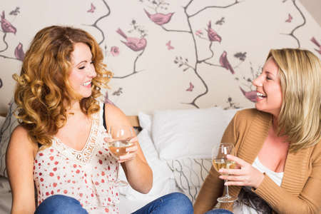 blonde woman: laughing women clinking glasses