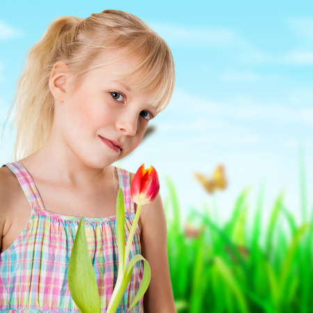 sincere girl: adorable young girl with a tulip
