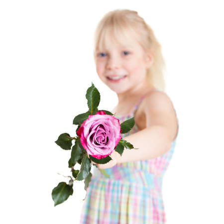 demure: adorable young girl with a rose on white background Stock Photo