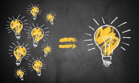many small ideas leading to the big picture symbolized by lightbulbs drawn on a chalkboard Standard-Bild