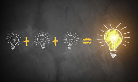 many small ideas leading to the big picture symbolized by lightbulbs drawn on a chalkboard Stock Photo
