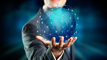 visions of america: businessman hold a holographic globe over his hand