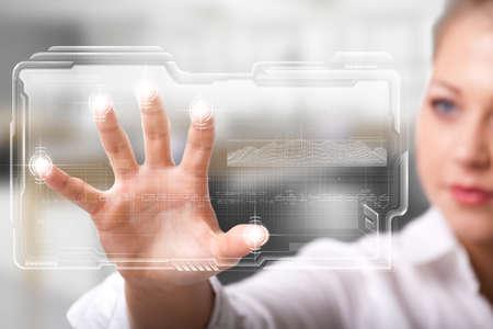 unlocking: businesswoman unlocking an interface via fingerprints Stock Photo