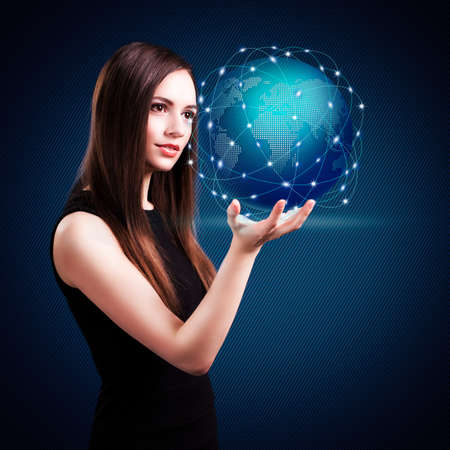 visions of america: woman holding a holographic globe over her hand Stock Photo