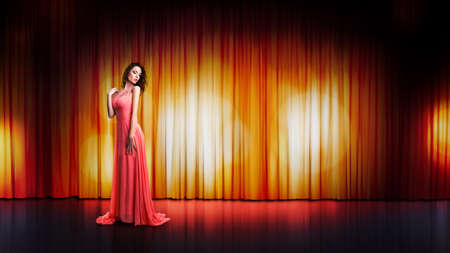 ravishing: young woman in a long dress on a stage Stock Photo