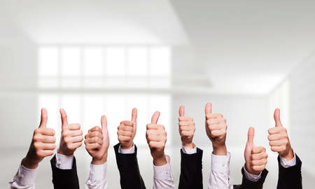 backing up: many thumbs up Stock Photo
